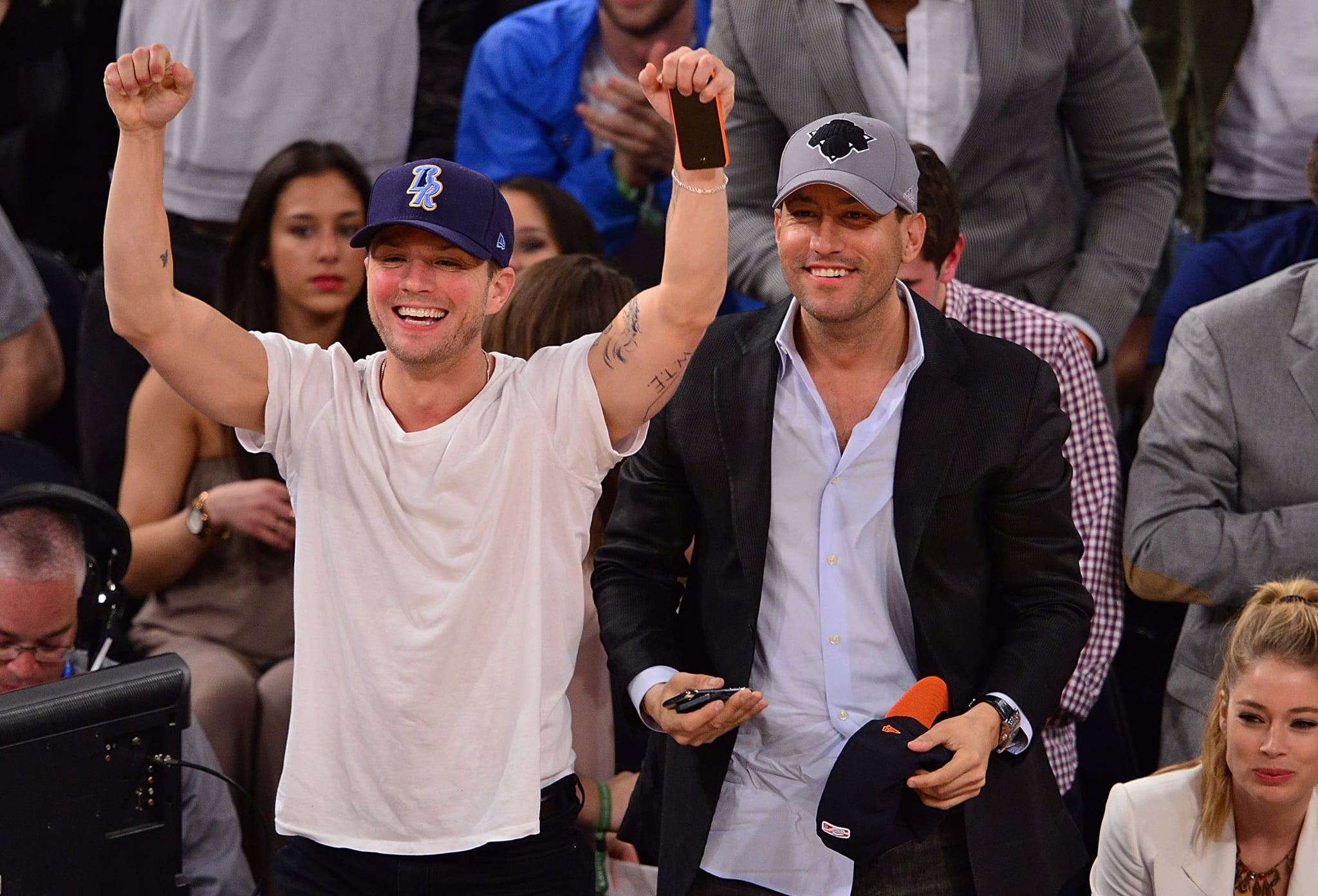 Ryan Phillippe and David Spencer cheered on the NY Knicks as they played the Washington Wizards in April.