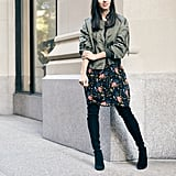 With a bomber jacket, this vintage-feeling print gets a new life. Dana added over-the-knee boots to further winterize the look.