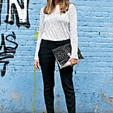 Nina Garcia paired her printed blouse with the perfect printed clutch.