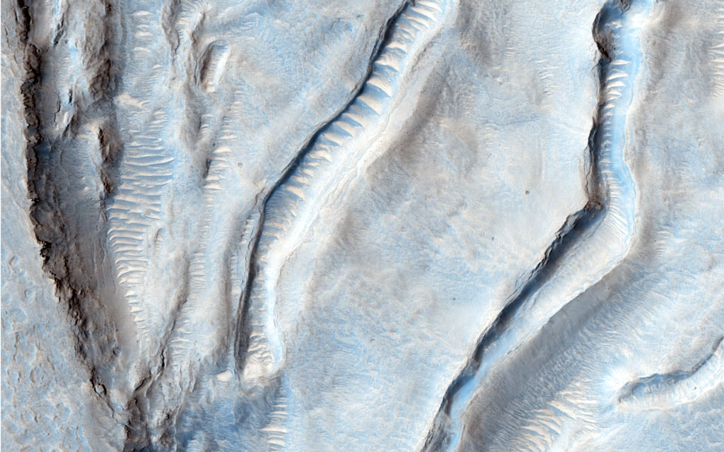 """Oxus Patera is an ancient, eroded depression in northern Arabia Terra. It is not known how Oxus Patera formed, though it has been suggested that the feature represents an ancient caldera formed through collapse and explosive volcanism."" Source: NASA/JPL/University of Arizona"