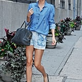 Miranda Kerr's denim-on-denim mix is an undeniably cool way to spend Summer. Just tuck a denim blouse into denim shorts, and you're good to go.