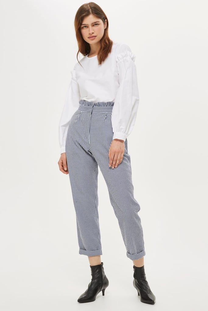 You won't be able to escape the gingham print train, so hop on board with these Topshop ruffle pants ($68).