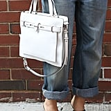A simplified satchel in standout white popped against boyfriend jeans.