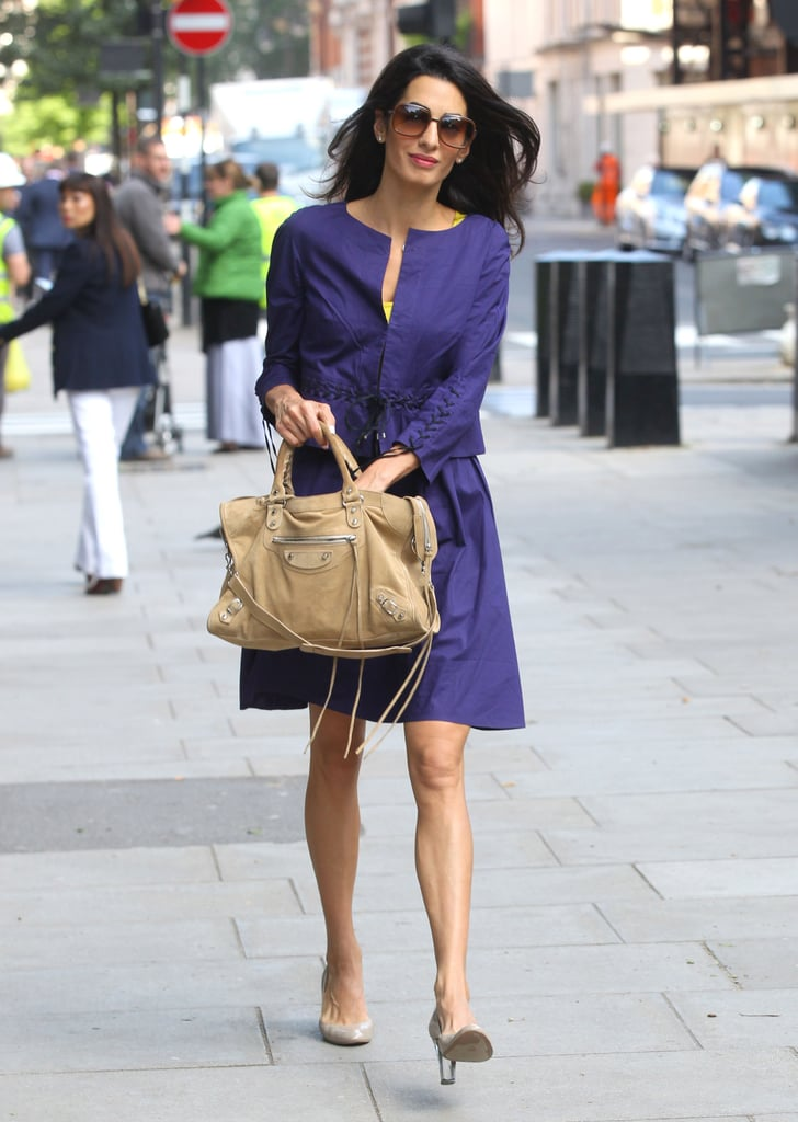 Amal let her jewel-toned separates take center stage with a neutral bag and flats. Casual Friday, anyone?