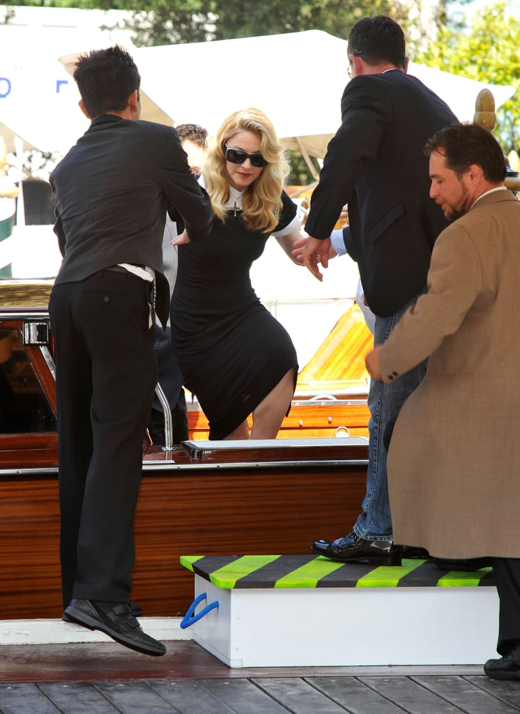 Madonna hopped out of a water taxi.