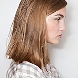 """""""Maybe because the economy is not that great, there is no time for flash or to be overdone,"""" Pita explained. """"And fashion often reflects social issues."""" To keep with this theme, stylists blow-dried the hair with their hands, then flat-ironed in a side to side motion to give it a slight wave."""