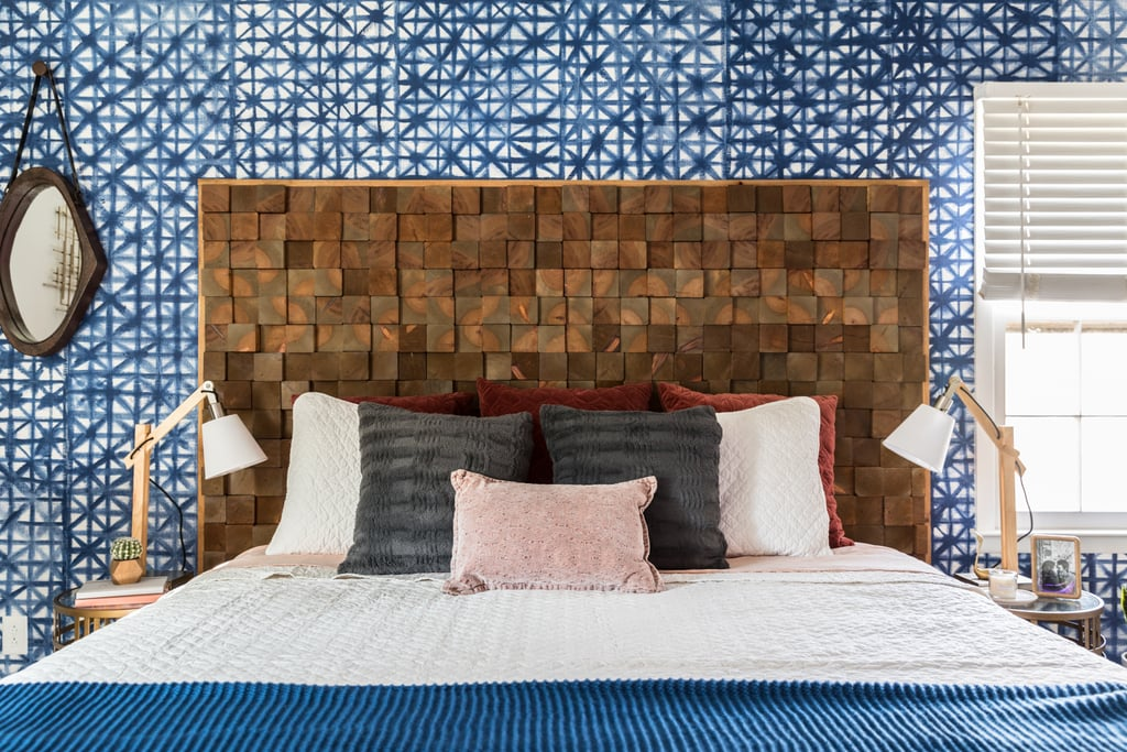 A painted shibori accent wall in the room's signature indigo blue anchors the room.