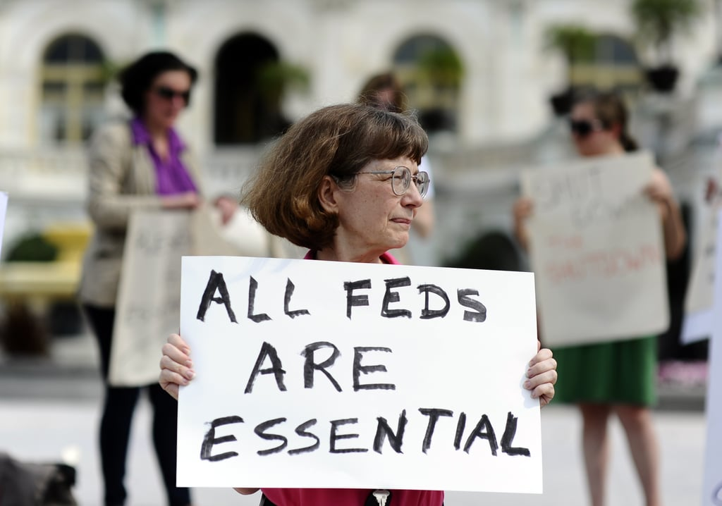 A woman held up a sign outside the US Capitol.