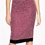 We love the punchy color and black contrast hemline on this J.Crew tweed pencil skirt ($298). We would juxtapose it with a basic white tee.
