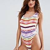 For something a little more scandalous, wear this Asos Rainbow Print Shirred High-Leg Swimsuit ($46).