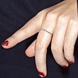 She sports holiday-themed nails.