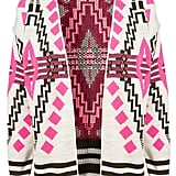 Give your look a tribal-inspired touch and wear this open over a your favorite t-shirt and cutoffs now; later, belt it up over a tank and high-waisted jeans for a cool twist on the Fall dress code.  Topshop Knitted Aztec Festival Cardi ($92)