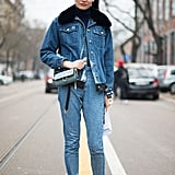 A Denim Jacket With a Furry Collar and Frayed Jeans