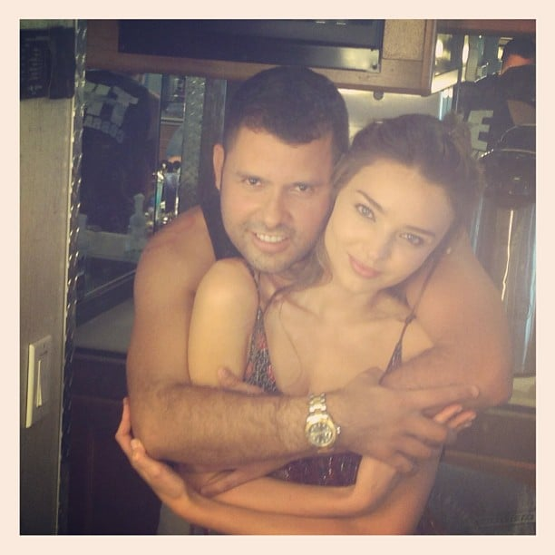 Miranda Kerr got a hug while on the set of a photo shoot. Source: Instagram user mirandakerr
