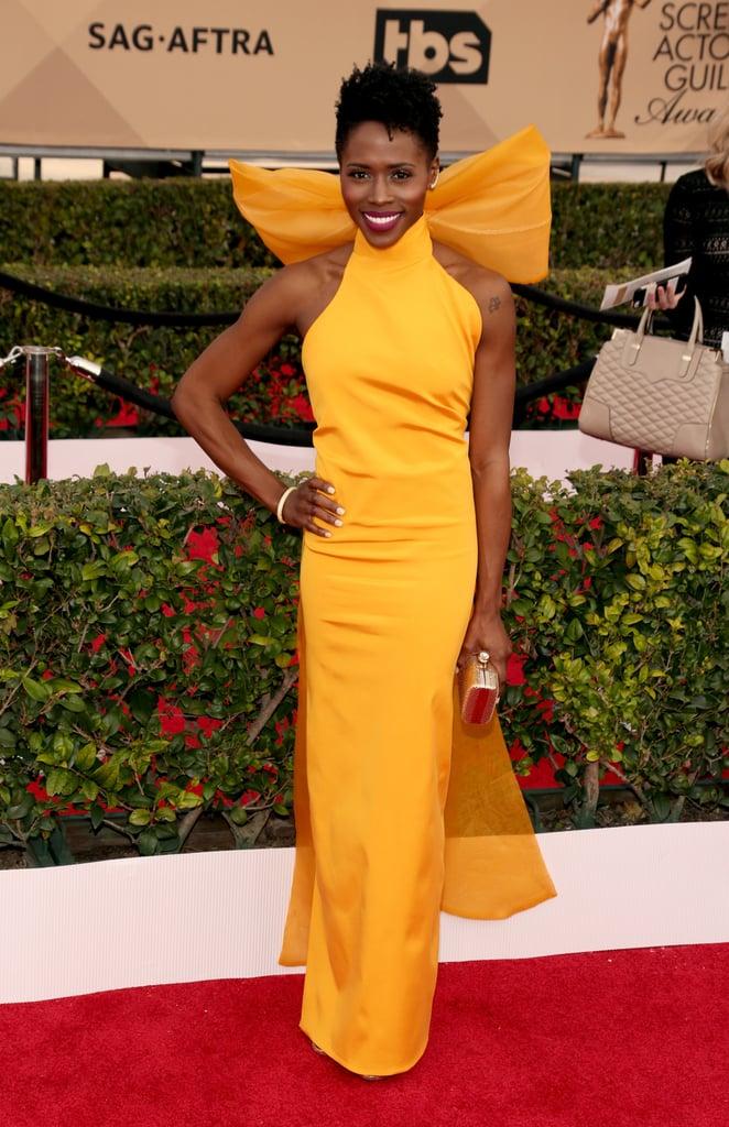 Sola Bamis in a sleek daffodil-yellow Lola Wusu gown.