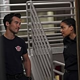 Jay Hayden and Barrett Doss in character as firefighters Travis Montgomery and Victoria Hughes.