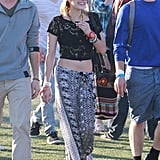 Emma Roberts kept cool in a floaty printed maxi skirt and lace crop top.