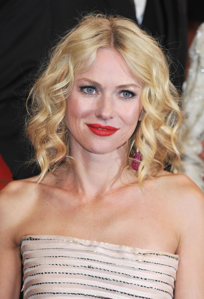 At the You Will Meet a Tall Dark Stranger premiere in 2010, Naomi did the red lip right, completing her look with loose curls.