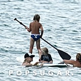 Kingston Rossdale tried to paddle board as mom Gwen Stefani and  brother Zuma held on.