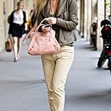 Bar Refaeli styled up a street-cool take on trousers, balancing the tomboy vibe with heels and a petal-pink Balenciaga.