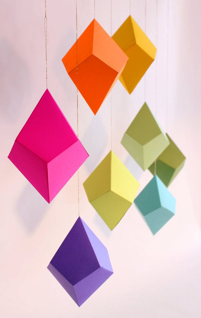 Hang these DIY Geometric Paper Ornaments ($24) all year round from a window or light feature to add colorful fun to your home.