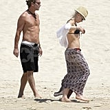 Shirtless Gavin Rossdale and bikini-clad Gwen Stefani walked on the beach.