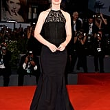 Mia Wasikowska's black lace halter gown stood out against the bright red carpet at the Tracks premiere.