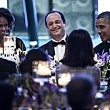 President Hollande took pride in his spot between his hosts.