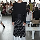 Olivia tempered a full-length skirt and romantic top with patent brogues at the Self-Portrait show.