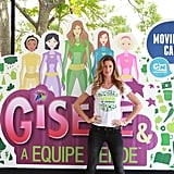 Gisele Bundchen posed in front of a poster for her new animated show.