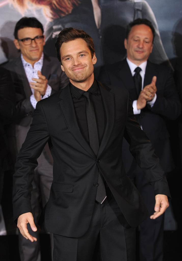 Sebastian looked handsome in a black suit.