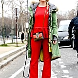 Bold red peplum and flares got a utilitarian finish with a fur-lined anorak and a military-style cap.