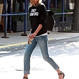 Karlie complemented the Reformation sweatshirt with a cool-girl backpack.