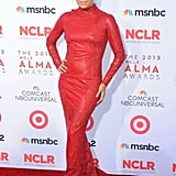 For one of her most dramatic looks of the night, Eva Longoria donned a red leather gown with long sleeves, a small train, and pretty lace insets — and it matched the Alma Awards red carpet flawlessly.