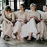 All four of these bridesmaids wore different style dresses that complemented each other gorgeously.