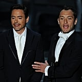Robert Downey Jr and Jude Law both opted for white neck accessories for their presenting duties.