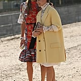 Fashion-forward duo Anna Dello Russo and Miroslava Duma make their mark in bold print and frills, respectively.