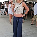 Wide-legged pants were paired with a crop lace top for a sweet throwback ensemble. Source: Chi Diem Chau