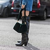 Carry a Velvet Handbag While Wearing a Pair of Western Boots