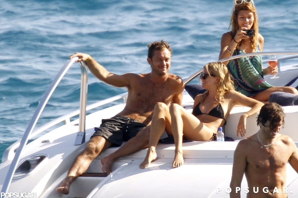 Sienna Miller and Jude Law soaked up the sun on a boat in Ibiza in August 2010.