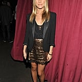 Kristin Cavallari paired black pointy pumps with a sparkly gold dress and tuxedo blazer on top.