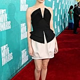 Emma Stone wore bright pink lipstick for the MTV Movie Awards.