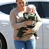 Hilary Duff and Luca Comrie walked through a parking lot with Luca Comrie.