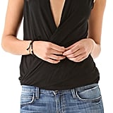 "The Tank: Lanston Surplice Pullover Top ($82) The Glowing Review: ""I've been oogling this top for the longest time and I finally purchased it. It's super soft material and fits true to size. Just be careful if you lean over. . . it is very open! Great for under a blazer on a night out!"""