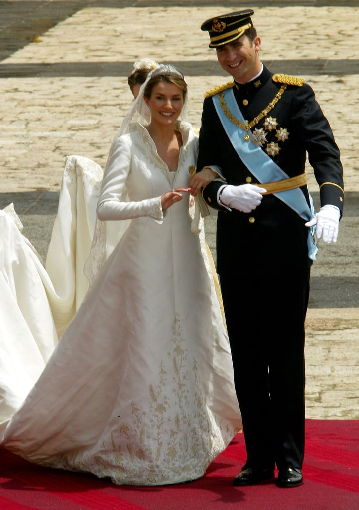 When Princess Letizia married Prince Felipe of Spain, she wore a very conservative number. The dress had long sleeves and a train which was softened with embroidered detailing.