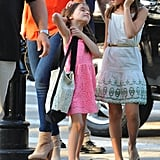 Suri Cruise fixed her hair.