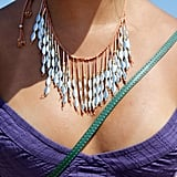 If you feel like you're showing too much skin, a big necklace can draw attention in just the right way.