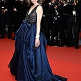 Milla Jovovich delivered dark glamour in an embellished navy gown at the All Is Lost premiere.