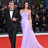 For the 2017 Venice Film Festival, Amal showed up to the red carpet in a stunning lavender Atelier Versace gown. She wore Aquazzura sandals and Lorraine Schwartz drop gemstone earrings.