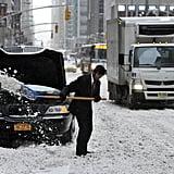 A man dug his limo out of the snow on NYC's 6th Avenue.